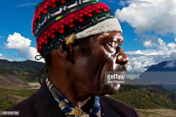 Chief Lot Sanda of Anawe in Porgera stands on traditional land next to processed ore dumps on the outskirts of the Porgera Joint Venture Mine Papua...