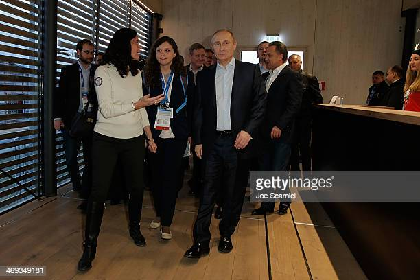 Chief Marketing Officer Lisa Baird greets Russian President Vladimir Putin for his visit to the USA House in the Olympic Village on February 14 2014...