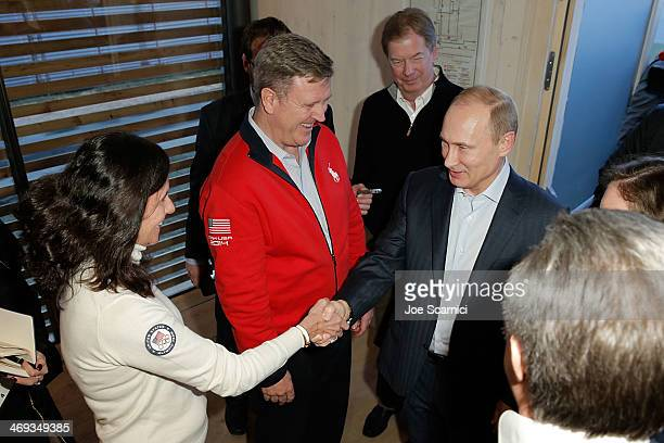 Chief Marketing Officer Lisa Baird shakes hands with Russian President Vladimir Putin as Chief executive officer of the US Olympic Committee Scott...