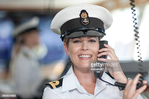 chief mate on bridge talking on radio - sailor hat stock pictures, royalty-free photos & images