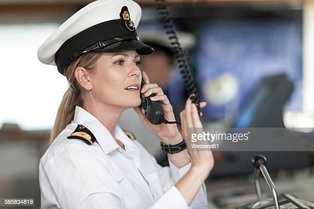 chief mate on bridge talking on radio - 乗員 ストックフォトと画像