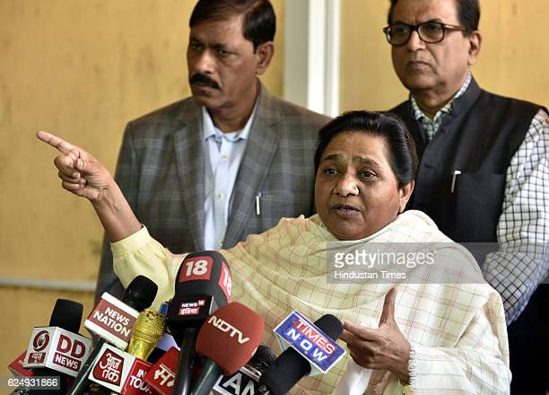 Chief Mayawati with Satish Chandra Misra addresses the media at Parliament during the Winter Session on November 21 2016 in New Delhi India In a move...
