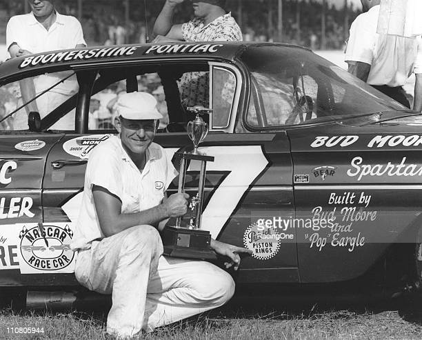 Chief Mechanic Bud Moore poses after his Pontiac was driven to victory by Buck Baker in the Southern 500 NASCAR Cup race at Darlington Raceway.