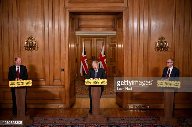 Chief Medical Officer Professor Chris Whitty, UK Prime Minister Boris Johnson and Chief Scientific Adviser Sir Patrick Vallance attend a coronavirus...