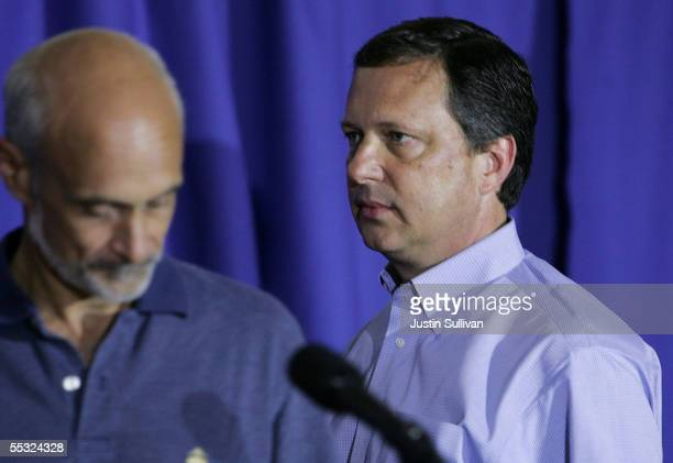 Chief Michael Brown looks on as Homeland Security Secretary Michael Chertoff speaks during a press conference September 9 2005 in Baton Rouge...