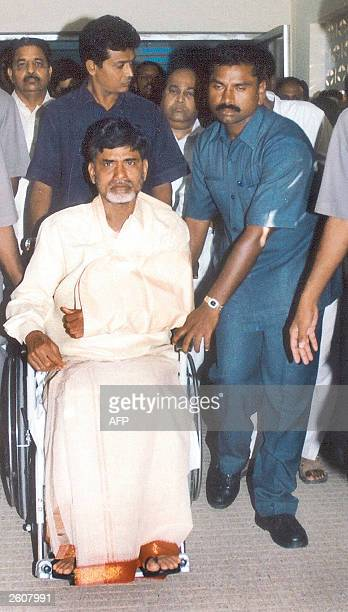 Chief Minister for the Indian state of Andhra Pradesh N Chandrababu Naidu is moved by wheelchair in Tirupati 02 October 2003 before being transfered...