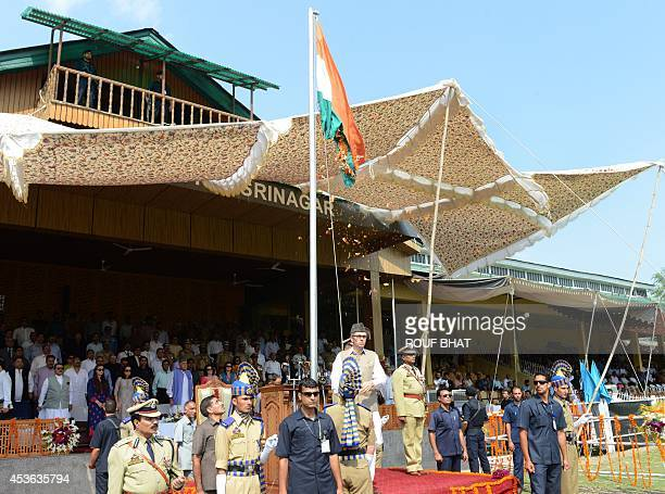 Chief Minister Jammu and Kashmir Omar Abdullah hoists the Indian flag during celebrations of India's 68th Independence Day at The Bakshi Stadium in...