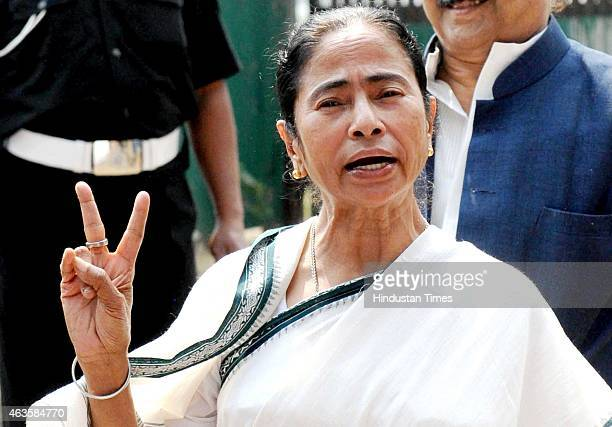 Chief Minister Mamata Banerjee flashes victory sign after winning the Bongaon Lok Sabha and Krishnaganj Assembly bypoll elections, on February 16,...
