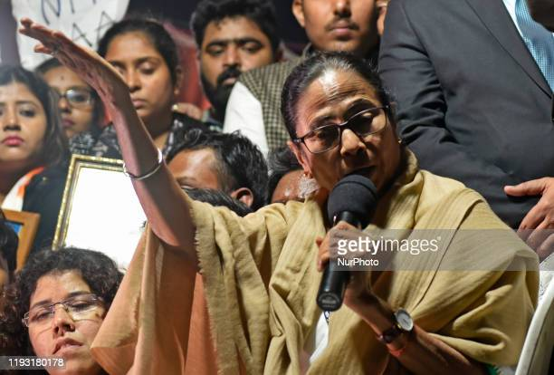 Chief Minister Mamata Banerjee reacts towards an angry protester while they participate in a protest rally against the arrival of India's Prime...