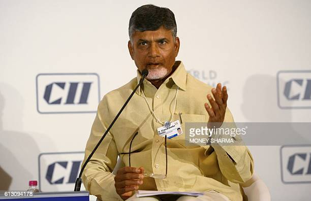 Chief Minister of Andhra Pradesh N Chandrababu Naidu gestures as he attends the session 'Cities as Engines of Growth' during the second day of the...