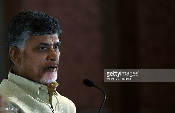 Chief Minister of Andhra Pradesh N Chandrababu Naidu looks on as he attends the session 'Cities as Engines of Growth' during the second day of the...