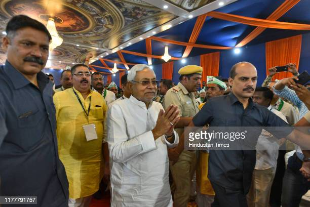 Chief Minister of Bihar Nitish Kumar gestures on his arrival to attend Janta Dal training camp, on October 23, 2019 in New Delhi, India.
