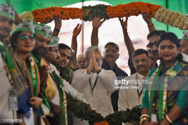 Chief Minister of Bihar, Nitish Kumar greets his supporters as he is garlanded by party workers during a Janta Dal training camp, on October 23, 2019...