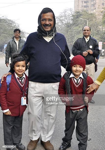 Chief Minister of Delhi Arvind Kejriwal on a morning walk with wife Sunita Kejriwal at Kaushambi on February 16 2015 in Ghaziabad India Kickstarting...