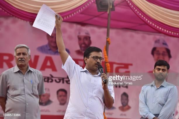 Chief Minister of Delhi Arvind Kejriwal speaks during a meeting with East Delhi RWA at Dhobhi Ghat Pandav Nagar opposite Akshardham Mandir on October...