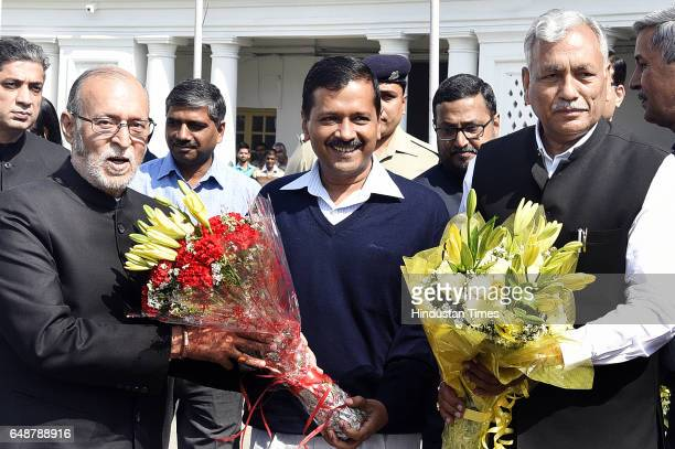 Chief Minister of Delhi Arvind Kejriwal talking with Delhi Assembly speaker Ram Niwas Goel present flower to Lieutenant Governor of Delhi Anil Baija...