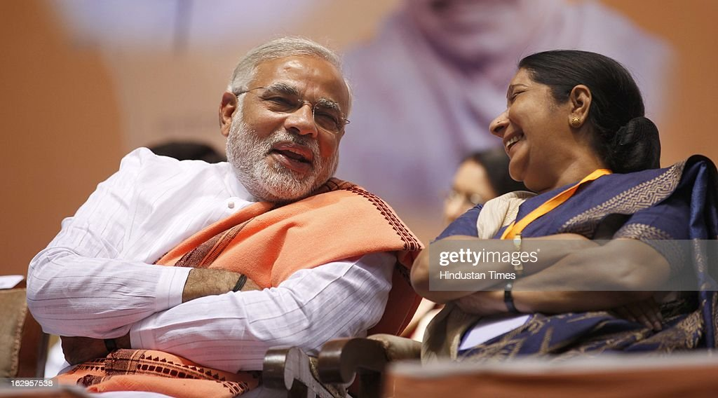 Chief Minister of Gujarat, Narendra Modi talking with Sushma Swaraj during Bharatiya Janata Party National Council meeting at Talkatora Indoor Stadium on March 2, 2013 in New Delhi, India. In his 90 minute presidential address Rajnath Singh asked the party ranks to be prepared for early Lok Sabha polls and crucial assembly elections this year, including in Karnataka, Madhya Pradesh, Chhattisgarh, Rajasthan and Delhi all very important states for BJP.