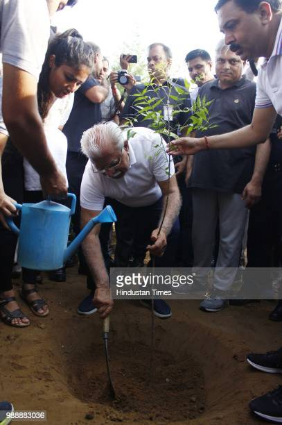 Chief Minister of Haryana Manohar Lal Khattar plant a sapling during a Raahgiri Day an event organised by MCG at Sector 55 Golf Course Road in...