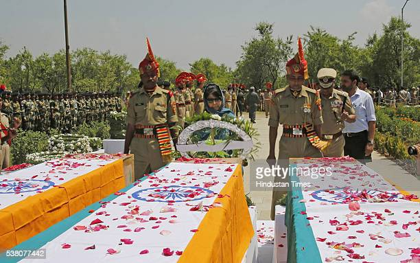 Chief Minister of Jammu and Kashmir Mehbooba Mufti lays a wreath on the coffins of three paramilitary soldiers during a wreath laying ceremony on the...