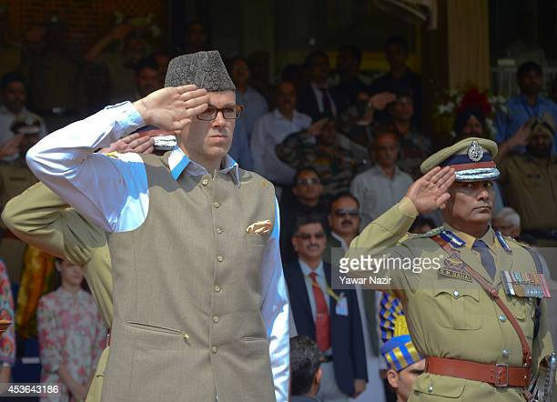 Chief Minister of Jammu and Kashmir Omar Abdullah salutes during India's Independence Day celebrations on August 15 2014 in Srinagar the summer...