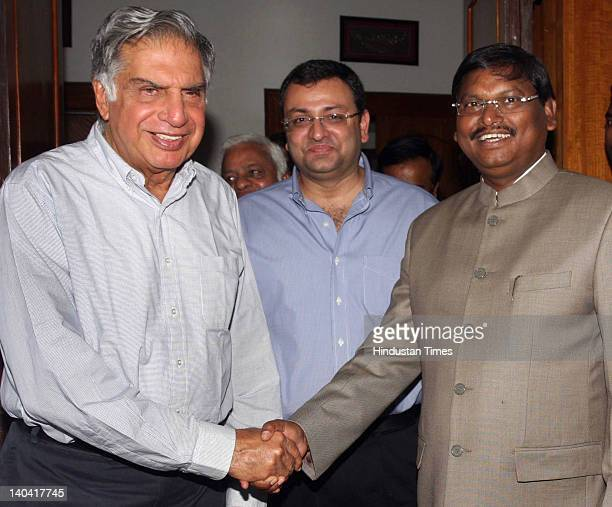 Chief Minister of Jharkhand Arjun Munda welcomes Tata group chairperson Ratan Tata and his deputy Cyrus Pallonji Mistry at his residence on March 2...