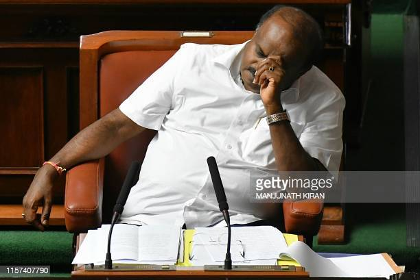 Chief Minister of Karnataka and Senior Janatha Dal leader Kumaraswamy closes his eyes during the state legislative assembly session at the Vidhana...