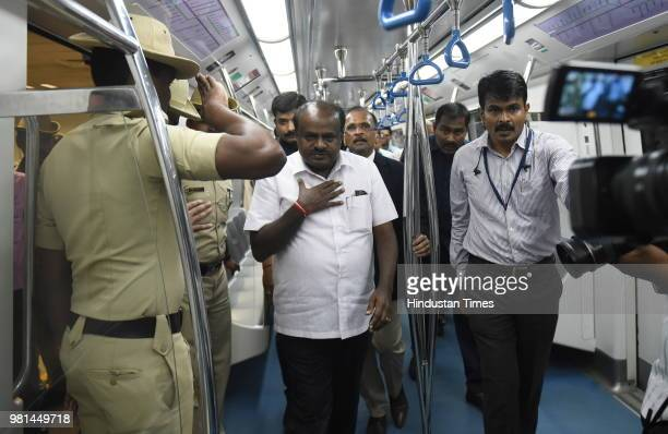 Chief Minister of Karnataka H D Kumarswamy waves after he flagged off the first six coach metro train in the city in presence of the Hardeep Singh...