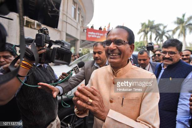 Chief Minister of Madhya Pradesh Shivraj Singh Chouhan arrives at party headquarters a day before the state election results on December 10 2018 in...