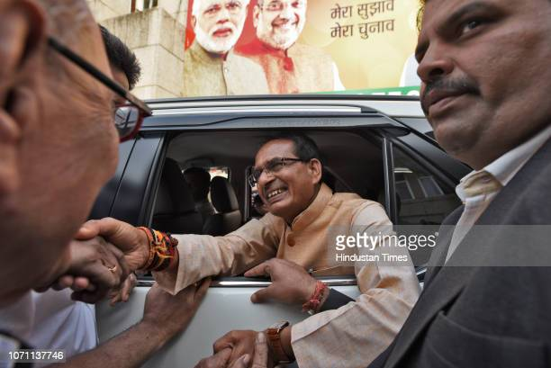 Chief Minister of Madhya Pradesh Shivraj Singh Chouhan greets his supporters at party headquarters a day before the state election results on...