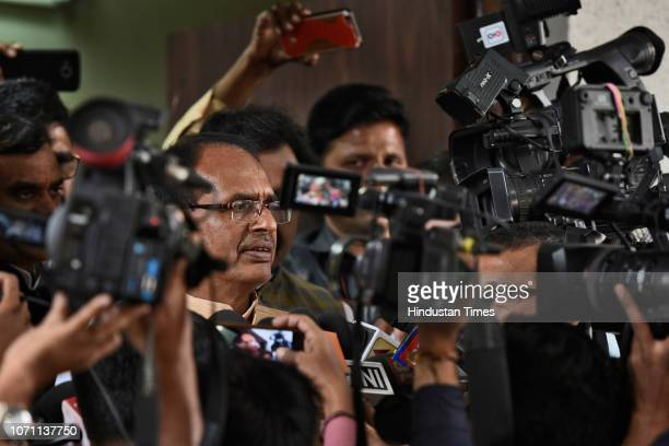 Chief Minister of Madhya Pradesh Shivraj Singh Chouhan talks to journalists at party headquarters a day before the state election results on December...