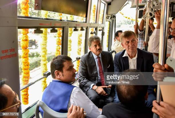 Chief Minister of Maharashtra Devendra Fadnavis along with State Minister of Health Harsh Vardhan and Entrepreneur Anand Mahindra travelling in...