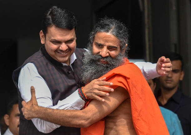 IND: Yoga Guru Baba Ramdev Meets Maharashtra CM Devendra Fadnavis In Mumbai