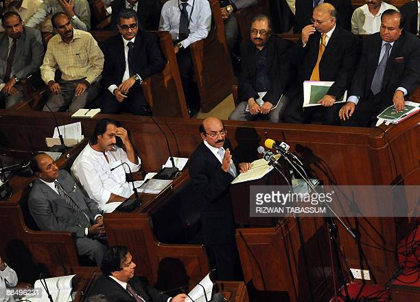 Chief Minister of Pakistan's southern Sindh province, Qaim Ali Shah, presents the annual budget in the provincial assembly in Karachi on June 15,...