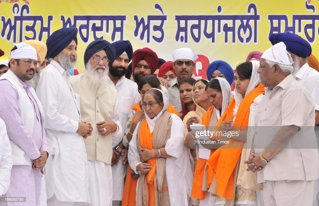 Chief Minister of Punjab Parkash Singh Badal along with Cabinet Minister Bikram Singh Majithia and others presenting the cheque and honoring the family of Indian prisoner Sarabjit Singh during his bhog ceremony at his native village in Bikhiwind on May 11, 2013 in Amritsar, India. In the presence of CM Punjab Parkash Singh Badal and former Union Minister Ambika Soni she demanded swift action in the case of other Indian prisoners locked in Pakistani Jails. Sarabjit Singh died on May 2, after a deadly attack by Pakistani inmates in Pakistan's Kot Lakhpath Jail in Lahore.
