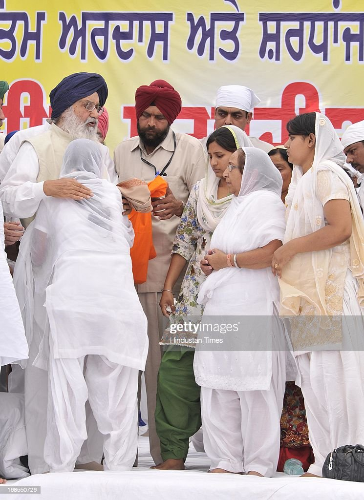 Chief Minister of Punjab Parkash Singh Badal condoling Sarabjit's wife Sukhpreet Kaur while presenting the cheque to his family members during the bhog ceremony of Sarabjit Singh at his native village in Bikhiwind on May 11, 2013 in Amritsar, India. In the presence of CM Punjab Parkash Singh Badal and former Union Minister Ambika Soni she demanded swift action in the case of other Indian prisoners locked in Pakistani Jails. Sarabjit Singh died on May 2, after a deadly attack by Pakistani inmates in Pakistan's Kot Lakhpath Jail in Lahore.