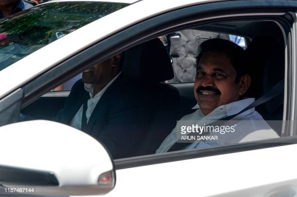 Chief Minister of Tamil Nadu Edappadi K Palanisami looks on as he takes a ride during the launch of Hyundai's India's first electric SUV 'KONA' at...