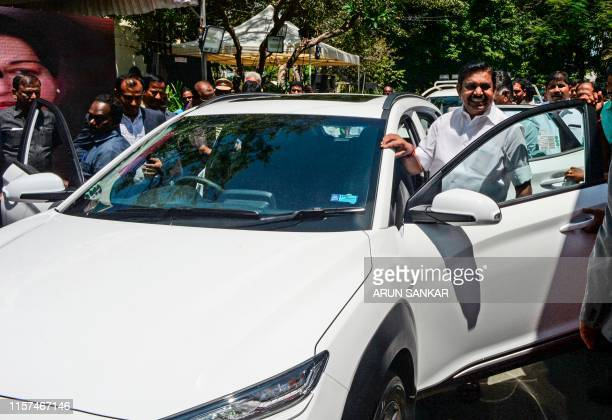 Chief Minister of Tamil Nadu Edappadi K Palanisami poses before taking a ride during the launch of Hyundai's India's first electric SUV 'KONA' at the...