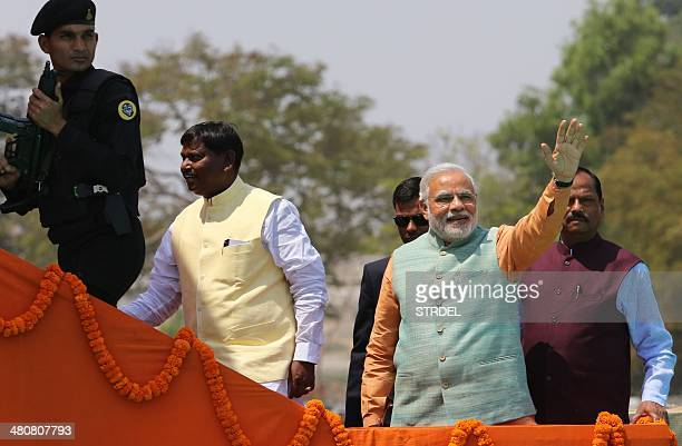 Chief Minister of the western Indian state of Gujarat and Bharatiya Janata Party prime ministerial candidate Narendra Modi waves to supporters...