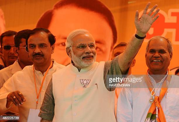 Chief Minister of the western Indian state of Gujarat and Bharatiya Janata Party prime ministerial candidate Narendra Modi waves to supporters during...