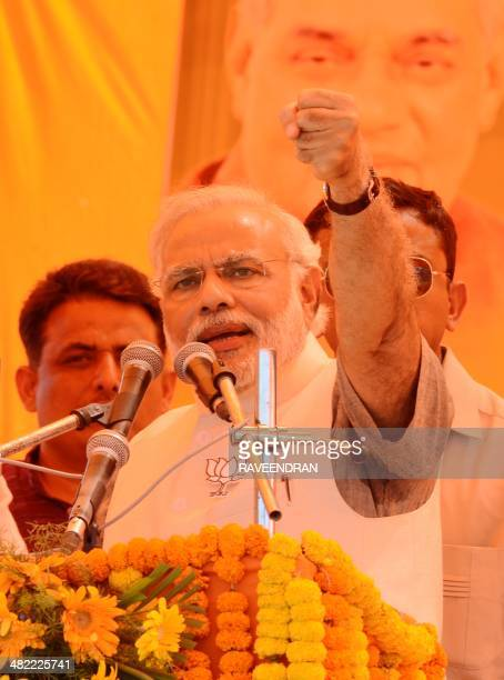 Chief Minister of the western Indian state of Gujarat and Bharatiya Janata Party prime ministerial candidate Narendra Modi speaks onstage during an...