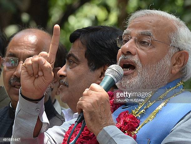 Chief Minister of the western Indian state of Gujarat and Bharatiya Janata Party primeministerial candidate Narendra Modi speaks after arriving at...