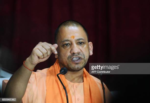 Chief Minister of Uttar Pradesh Yogi Adityanath gestures during a press confrence after visiting the Baba Raghav Das Hospital in Gorakhpur in the...