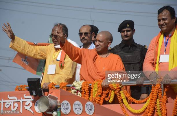 Chief minister of Uttar Pradesh Yogi Adityanath gestures towards a crowd during a political rally ahead of a legislative assembly election at...