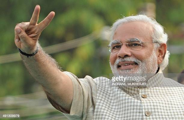 Chief Minister of western Gujarat state and main opposition Bharatiya Janata Party prime ministerial candidate Narendra Modi flashes the victory sign...