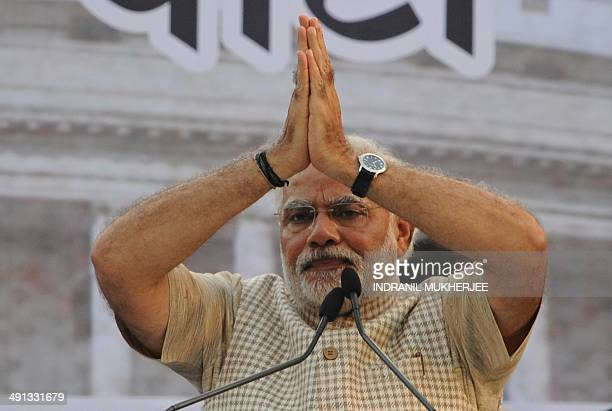 Chief Minister of western Gujarat state and main opposition Bharatiya Janata Party prime ministerial candidate Narendra Modi gestures to the crowd...