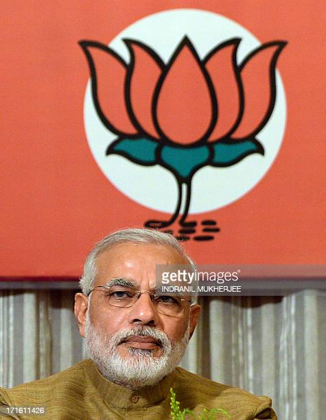 Chief Minister of western Gujarat state and senior leader of the main opposition Bharatiya Janata Party Narendra Modi attends a corecommittee meeting...