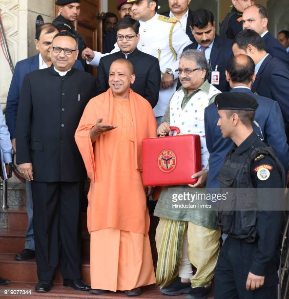 Chief Minister Yogi Adityanath along with Finance Minister of UP government Rajesh Agarwal show a red briefcase to present the state Budget for...