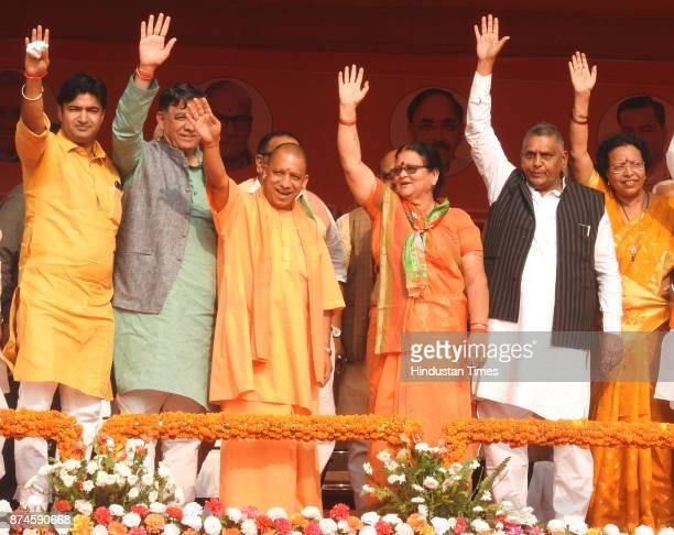 Chief Minister Yogi Adityanath From his Right MLA Abhijeet Singh Sanga and Cabinet Minister Satish Mahana From his left Mayoral candidate Pramila...