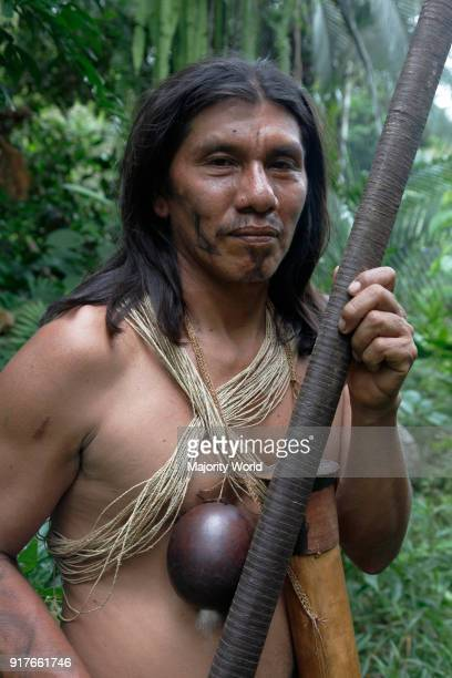 Chief Moi Enomenga in traditional warrior dress Huaorani Amerindians trying to survive through ecotourism against the threat of oil multinationals...