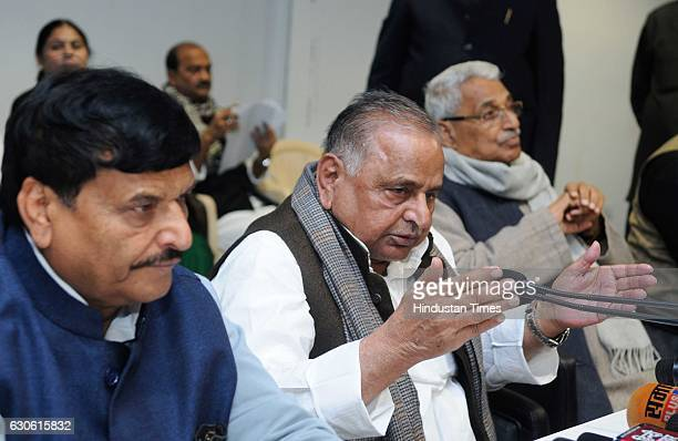 Chief Mulayam Singh addressing media along with Shivpal Yadav during a press conference on December 28 2016 in Lucknow India Ruling out any prepoll...
